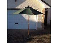 Garden fabric parasol with wooden frame; cast iron parasol base