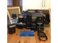 Original Olympus OM10 35mm SLR Camera plus lenses, flash, filters and case