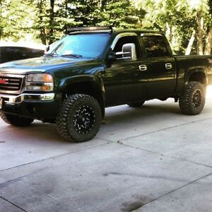 2004 gmc 1500 lifted trade for right car  London Ontario image 1