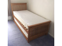 Great condition, single bed with pull-out bed and both mattresses