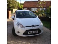 Superb Ford Fiesta 1.25 Zetec for sale in white.
