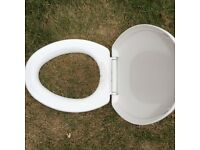 New toilet seat with lid