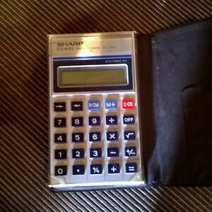 SHARP CALCULATOR - FOR NORMAL CALCULATIONS AND METRIC CONVERSION