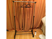 Clothes rack, quick assemble, 11 piece, never been used, surplus.