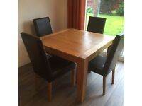 Solid Oak Dinning Table & Four Chairs