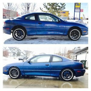 "2003 Sunfire 5 Speed 2 door.  2"" drop. Cash/Trade"