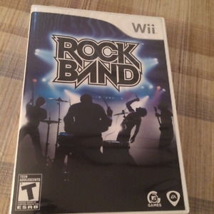 Wii Rock Band Guitar and Drums Set (asking $100.00)