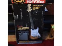A Fender Squier Strat Electric Guitar with Amp