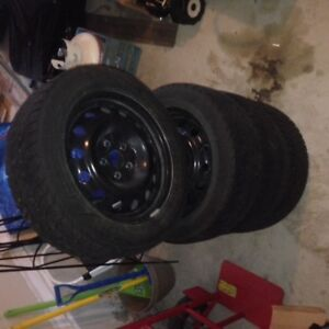 Four Used Winter Tires,Goodyear Wrt Ultra Grip Ice , on Rims