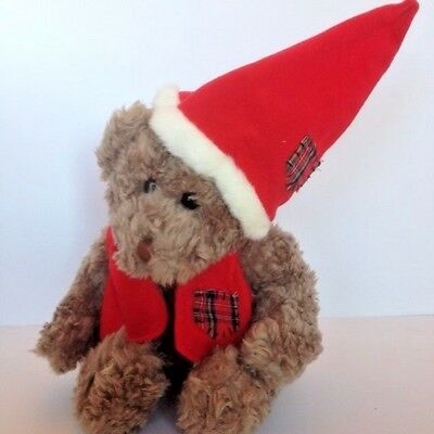 Plush Christmas Teddy Bear Muffles with red hat and matching vestby Ganz, 1995