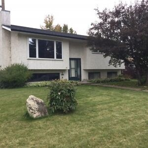 Huge Lot! Close to the Lake! A Must see 4 Bed with Garage