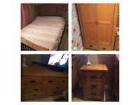 Solid oak bedroom furniture double bed wardrobe chest of drawers and 2 bedside tables