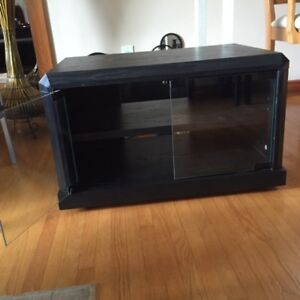 Black TV stand with glass doors and beveled top & front