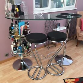 Contemporary glass and chrome drinks cocktail bar with 2 x black leather stools