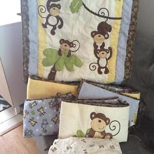 Monkey bedding set with extra sheets, protector and wall decor.