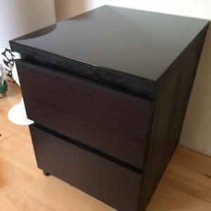Two Ikea Malm bedside tables with glass tops