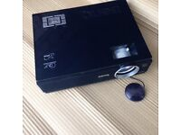 Projector by Beno with carry case and remote with cables