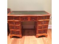 Beautiful office desk with green leather inlay.