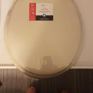 NEW UNOPENED SOFT TOILET SEAT