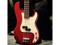 Red Encore Electric Bass Guitar with white pearloid Scratch Plate and hard case