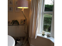 Floor lamp with lampshade and dimmer.