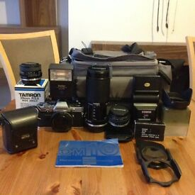 Original Olympus OM10 35mm SLR Camera plus lenses, flash, filters and case