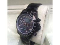 Black Rolex Daytona with Multiclored Universe Mother of Pearl Face in Rolex Bag and Rolex Box