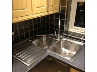 Franke stainless steel corner sink unit with mixer tap