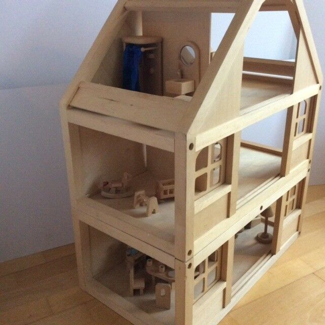 Elegant Wooden Dolls House With Furniture And Wooden Doll Family