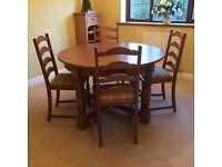 extending circular oak dining table and four matching oak dining chairs - Oak Table And Chairs