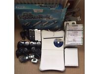 Nintendo Wii including Wii Fit Plus balance board and multiple handsets and games