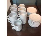 20 white teacups and 26 white saucers