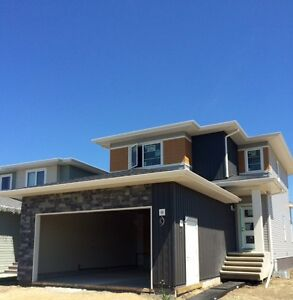 Two Storey - Open Design with Front Attached Garage- Red Deer