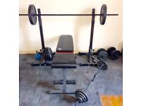 110kg assorted weights, bench and bars for sale
