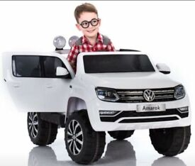 Licensed 12v VW AMOROK ride on car with remote control music and lights (leeds) only £270