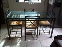Ikea Table and chairs. Glass top metal frame