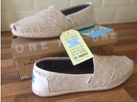 Natural woven TOMS shoes