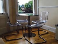 John Lewis Glass dining table with 4 clear chairs