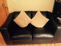 Black leather 2 seater sofa from DFS like new