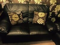 Two dark brown leather sofa and coffee table for sale