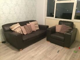 Brown leather sofa and arm chair.