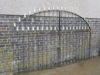 For sale, a pair of Decorative wrought iron gates measuring approx, width 2.7m x 1.9m High