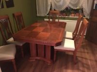 yew dinning table and 6 chairs
