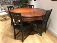 Round Dining Table - unique detailing, great condition.
