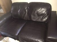 Faux black leather two seater sofa