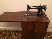 Singer sewing machine in cupboard