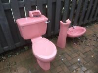 Retro toilet and sink in pink