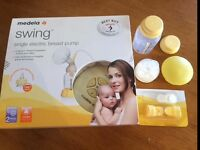 Medela swing breast pump and extras