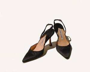 Manolo Blahnik , black satin sling-back pumps