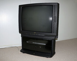 "JVC 32"" TV with JVC stand on wheels."